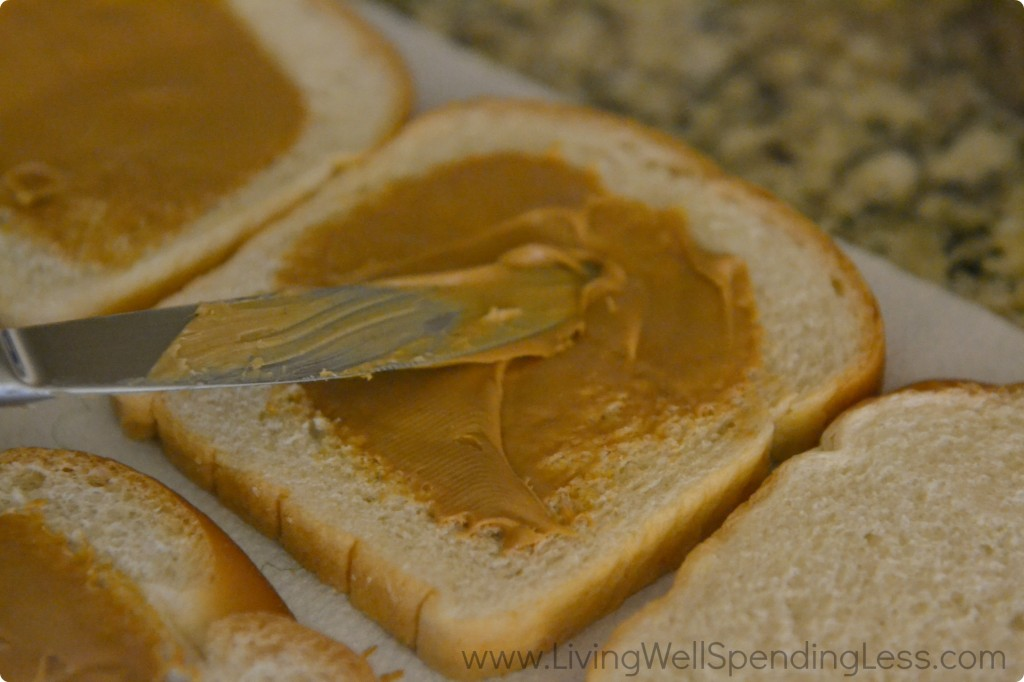 Add peanut butter to each slice of bread, avoiding the edges.