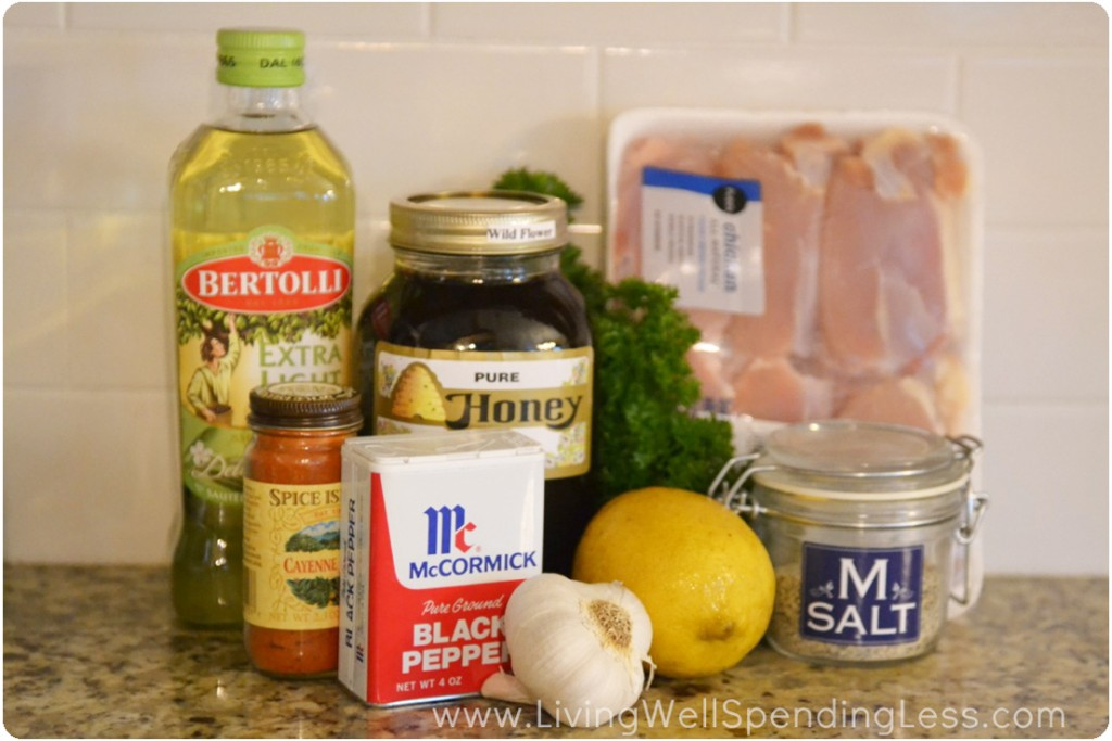 Assemble the ingredients for this easy chicken recipe: olive oil, chicken, honey, lemon, garlic and seasoning.
