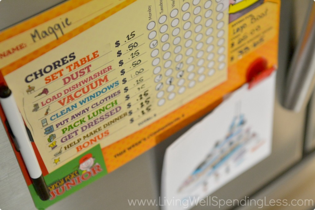 Posting a chore chart on the fridge helps kids track their allowance earnings.