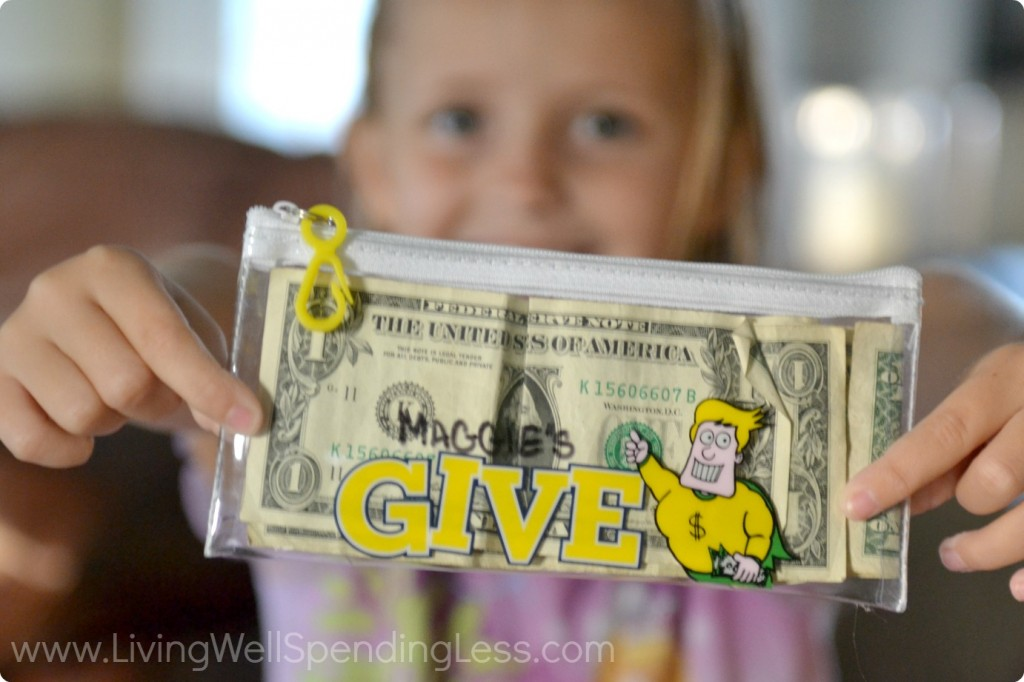 Help kids set aside money to give and place it in a special wallet, like this cute clear giving pouch.