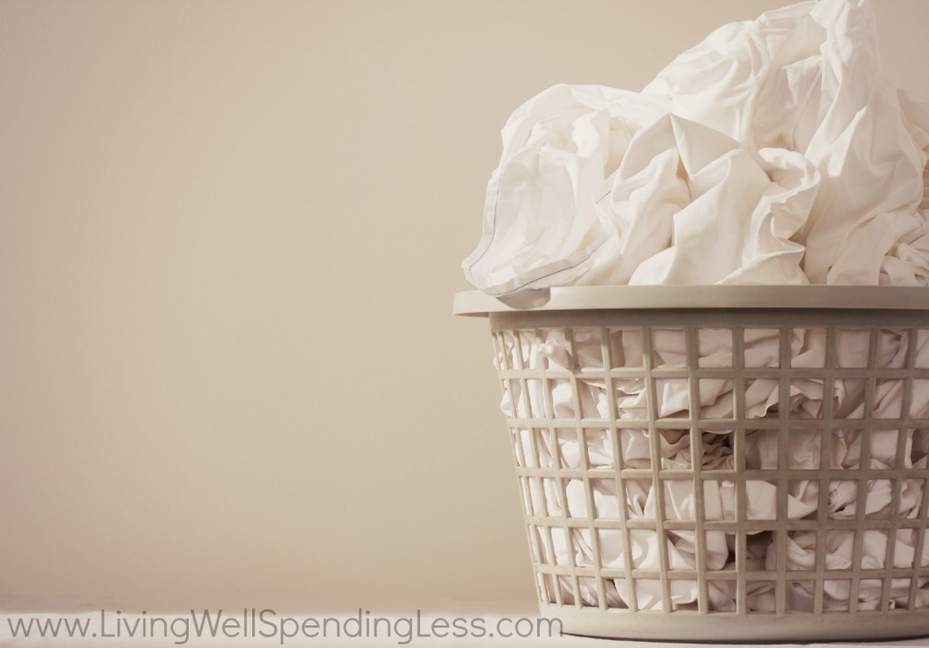 Separate all white fabrics into a single laundry bin together.