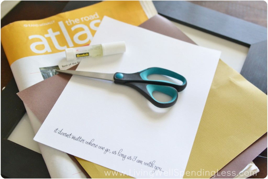 Gather the supplies: an old atlas, scissors, paper and glue.