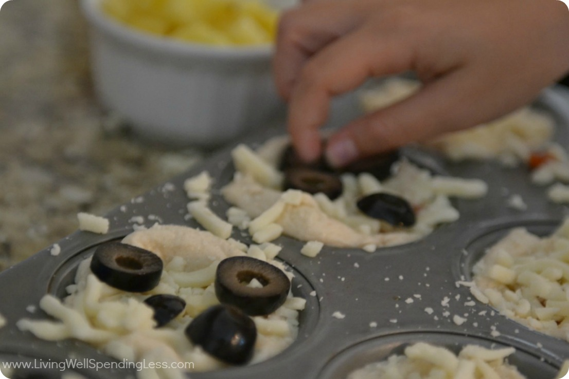 Add olives to mini pizzas