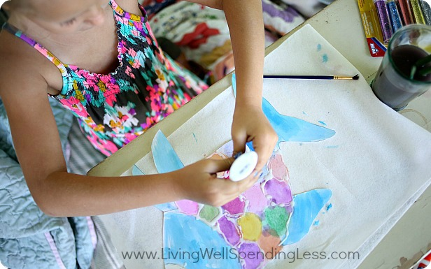 After your fish is painted and dried, outline a scale pattern using the glue.