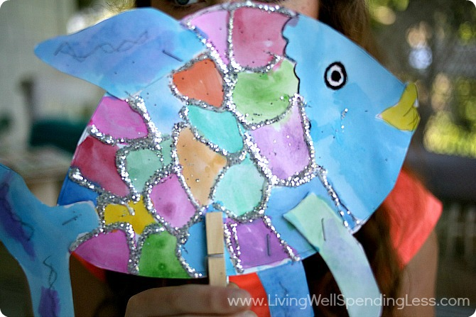 Add a clothes pin to your colorful rainbow fish to make a puppet out of him.