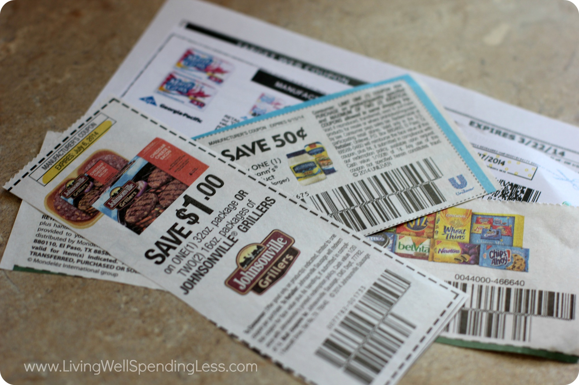 Several different coupons cut up and ready to be used.