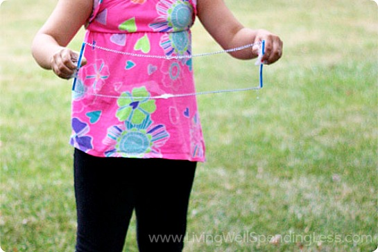 Dip the straw wand into the bubble mixture and begin to play outside.