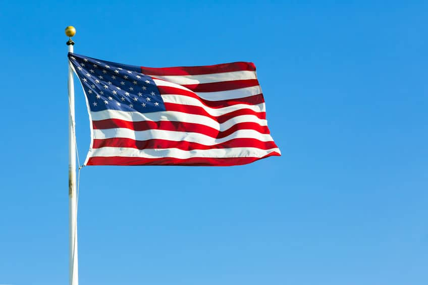 40214856 - american flag against clear blue sky