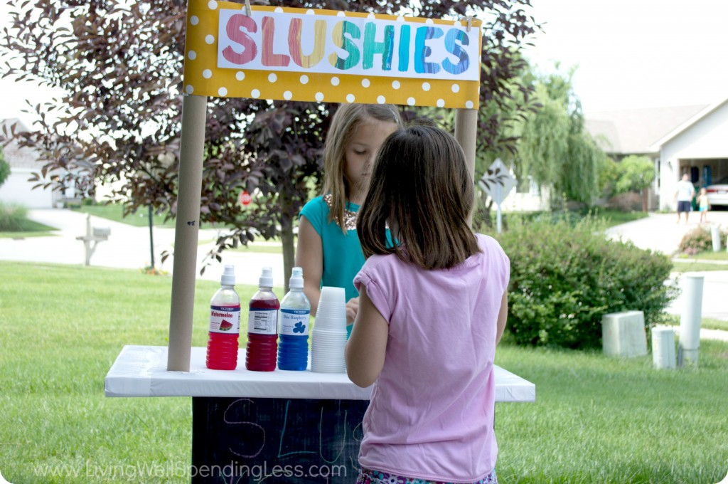 This diy slushie stand is a fun way to keep your kids entertained this summer