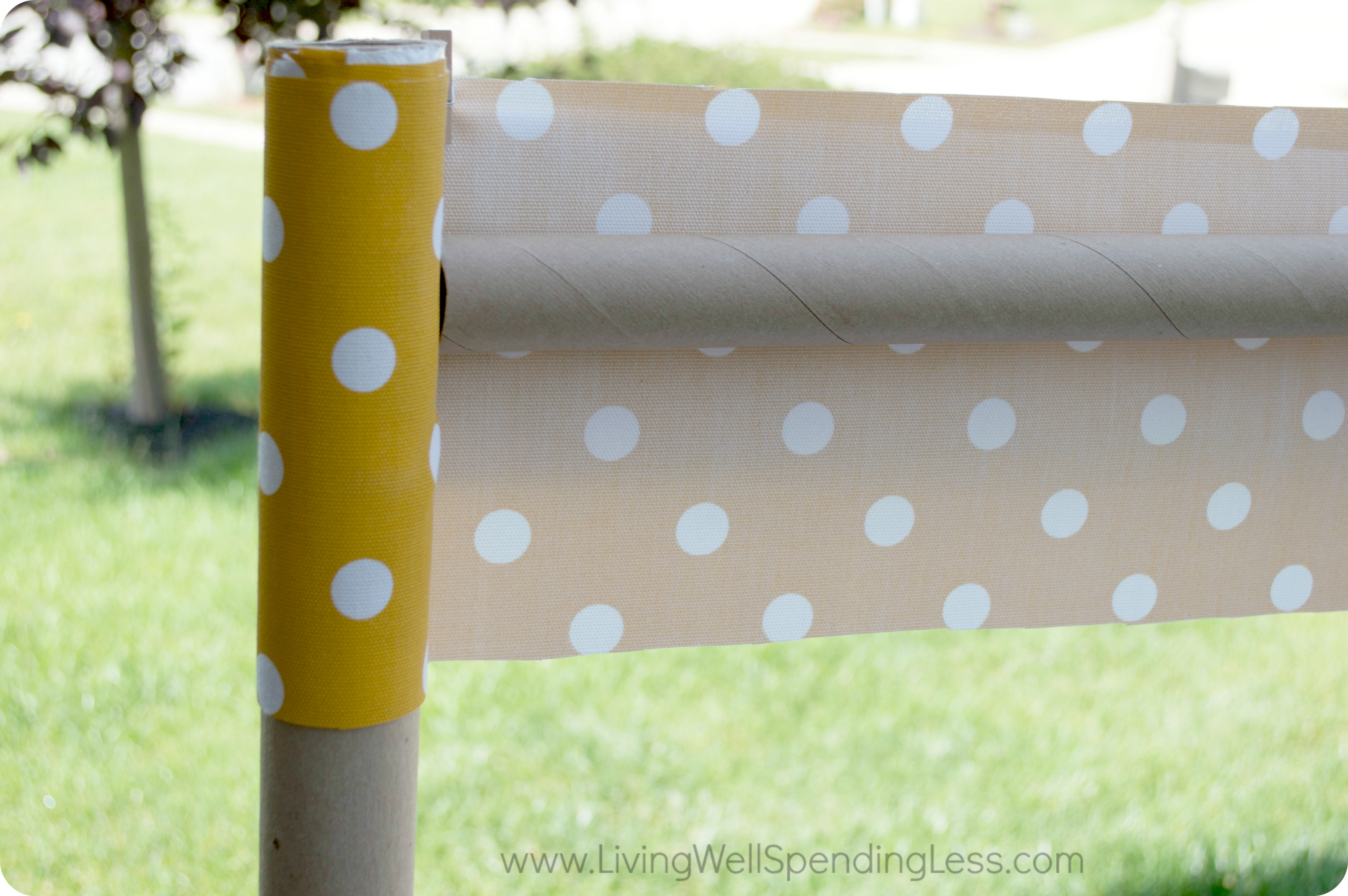 Use the cardboard tubes and fabric for a banner