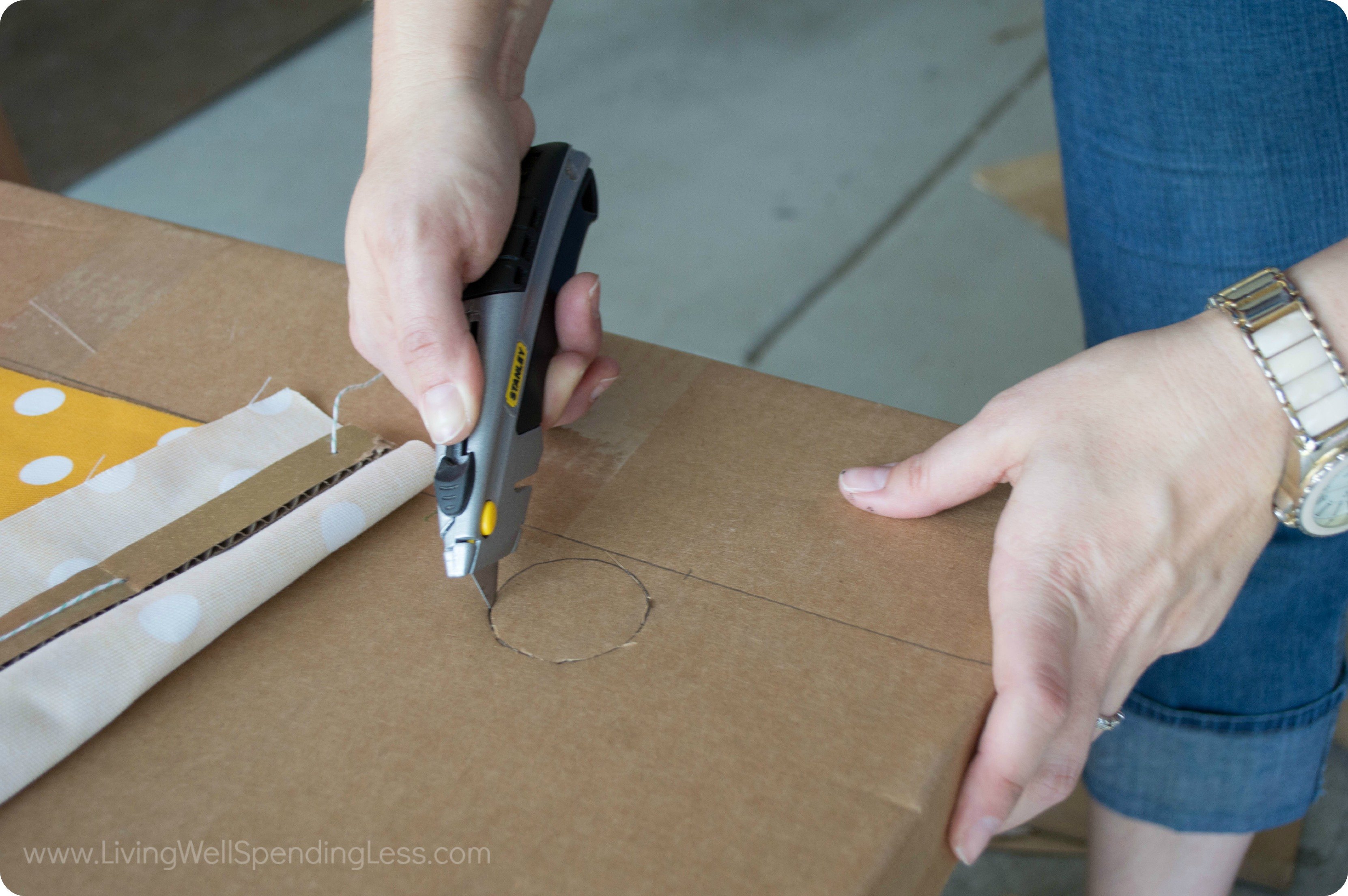 Carefully cut circles in the cardboard counter