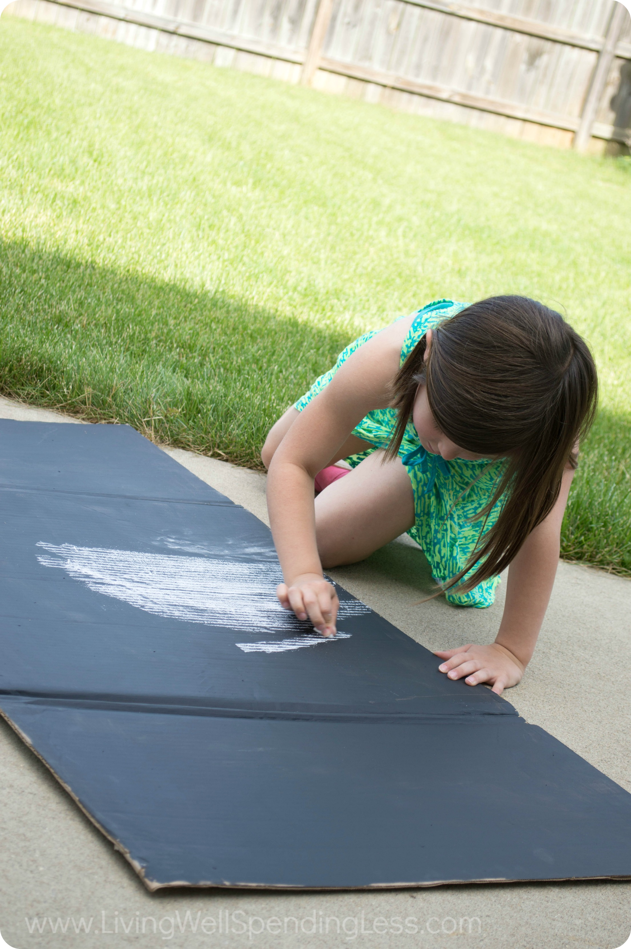 Use chalkboard paint for the cover and let your kids decorate it with chalk