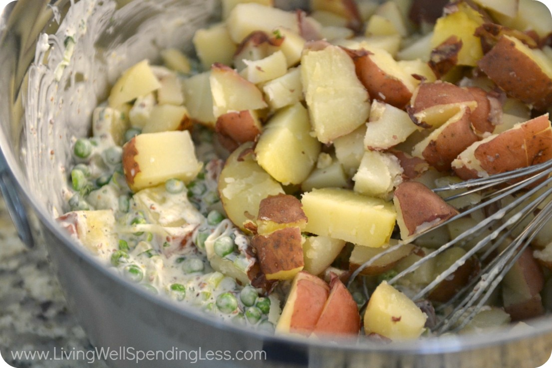 Mix potatoes into the creamy salad mixture and chill