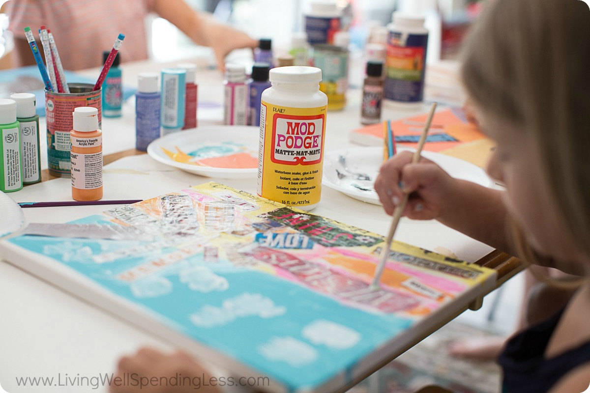 Use paint brush to apply Mod Podge to the entire surface of the painted canvas.