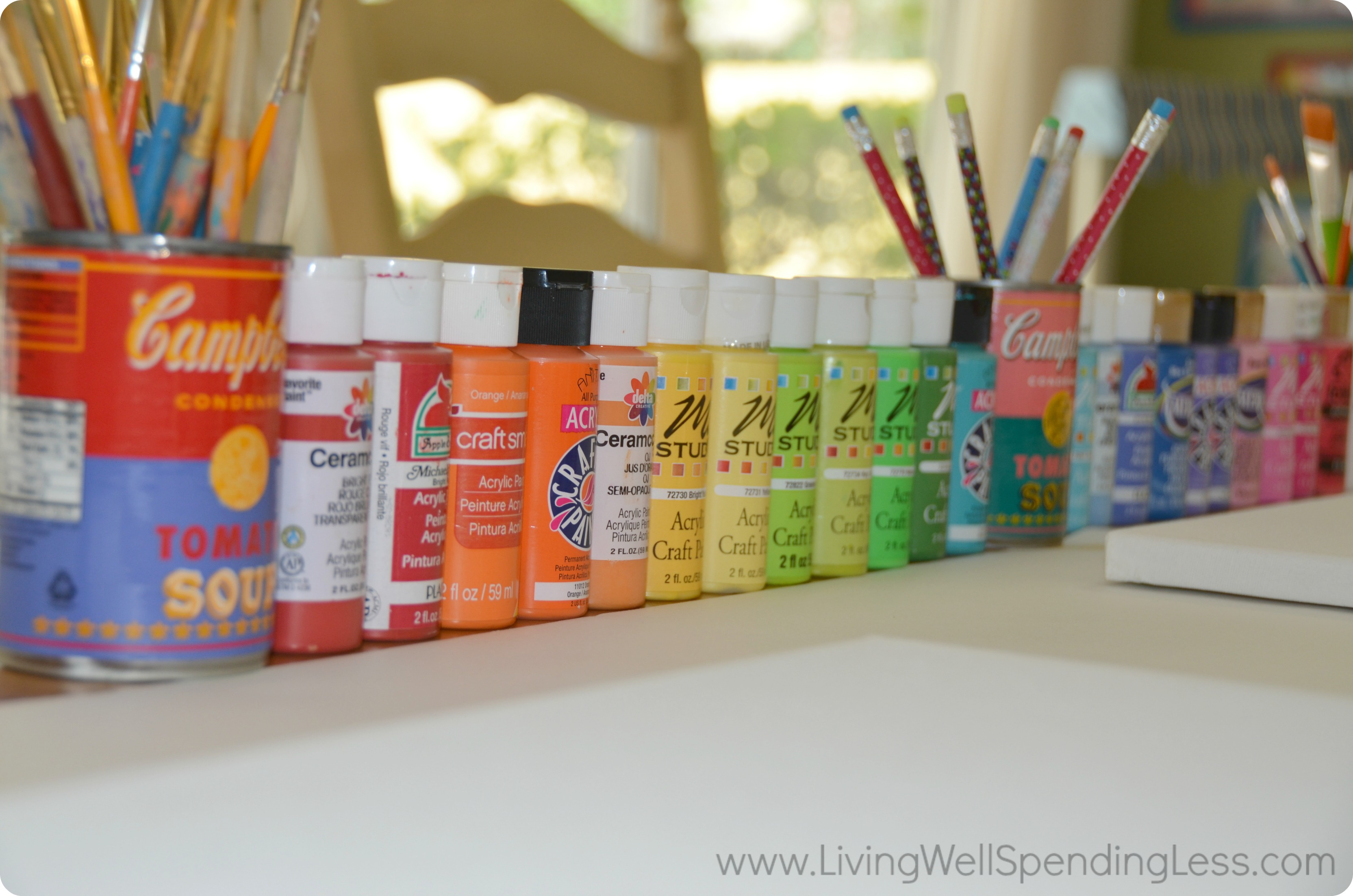 Have an assortment of acrylic paints and paint brushes available to use.