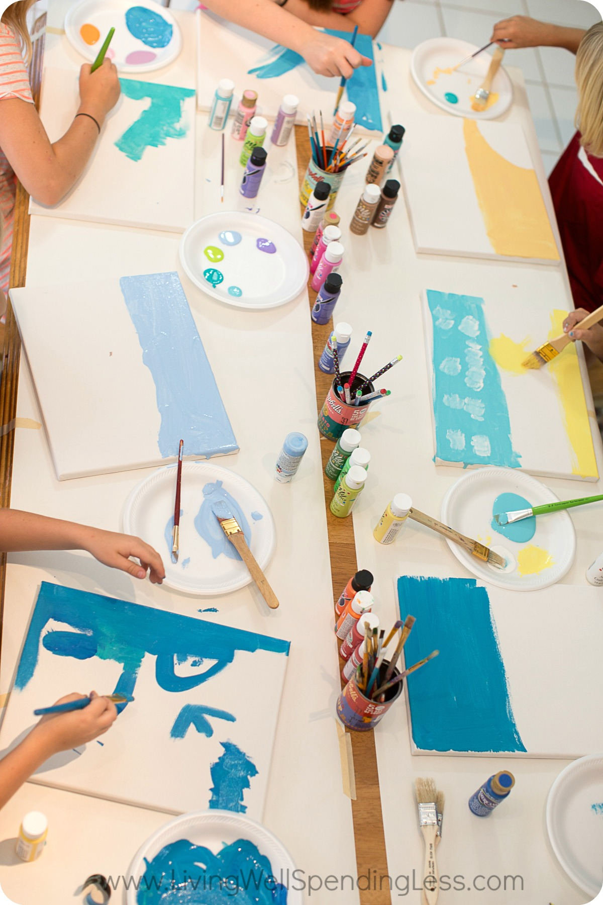 Organize materials onto table and let children begin to paint with acrylic paints.