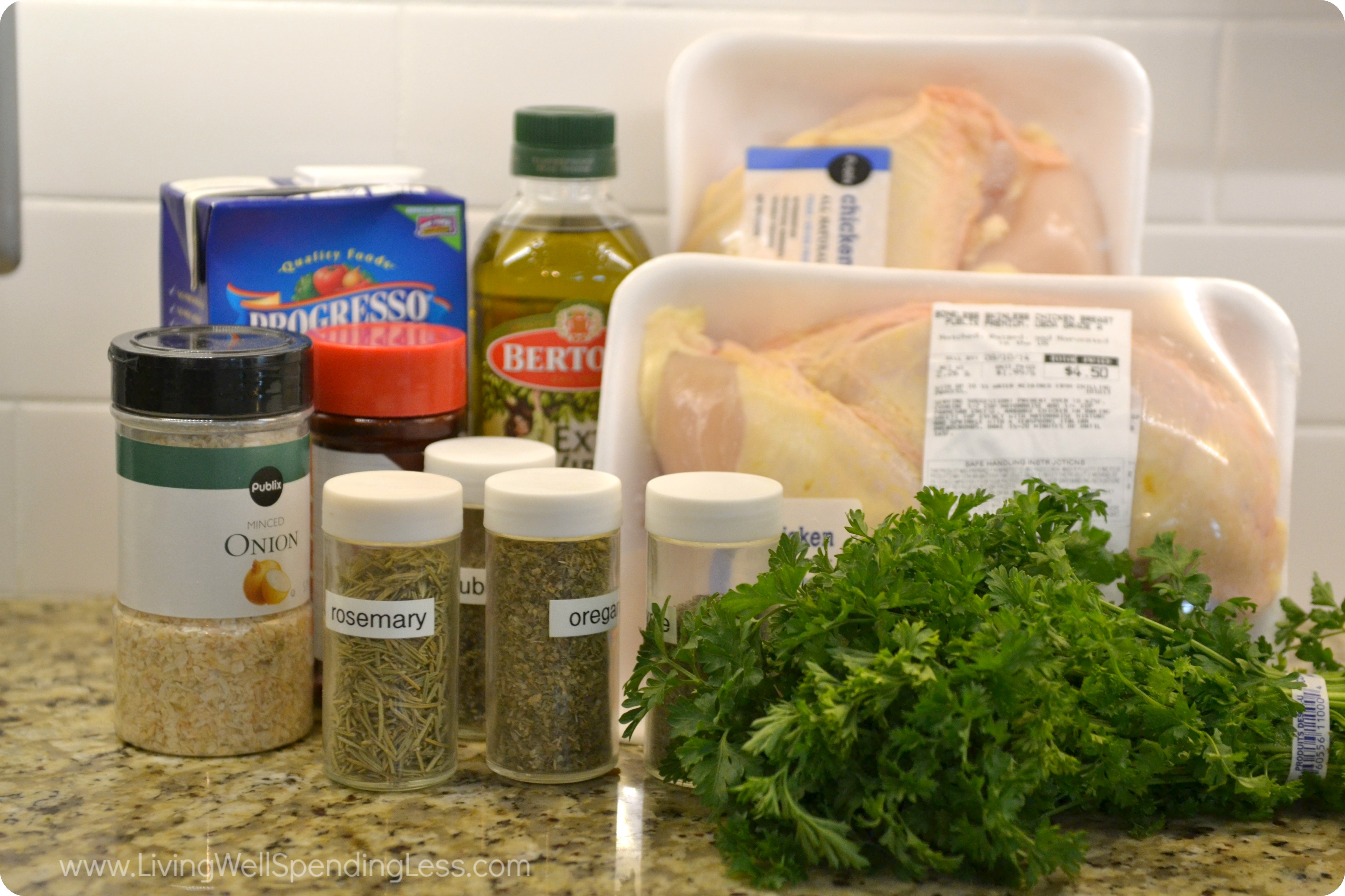 Assemble all the ingredients for herb roasted chicken: Olive oil, onion, chicken, fresh and dried herbs.