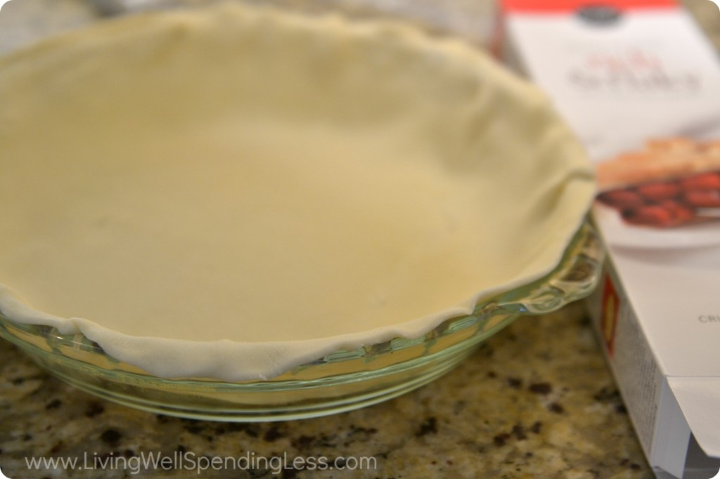 Roll out the pie crust into a clear glass pie dish.