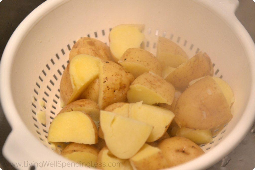 Drain cooked potatoes in a colander.