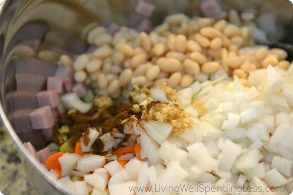 Assemble all the ingredients in a large bowl: ham, beans, onions, celery, carrots and spices.