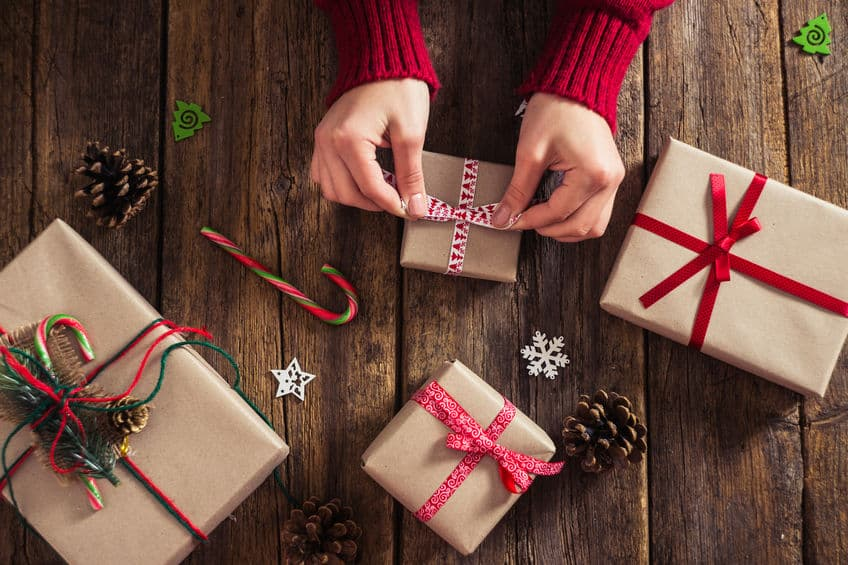 Use plain brown bags to wrap gifts. Add color with ribbons and bows.