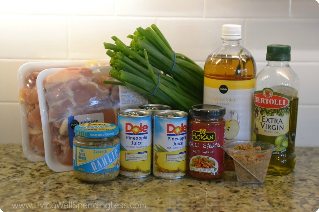 Assemble your sweet and spicy chicken ingredients: green onion, olive oil, garlic, pineapple juice, chili sauce with garlic, vinegar, sugar, soy sauce, and chicken.
