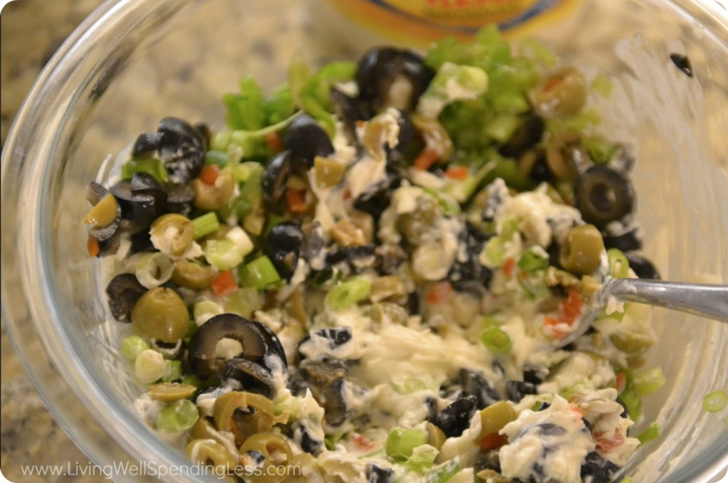 Mix green and black olives into mayo spread