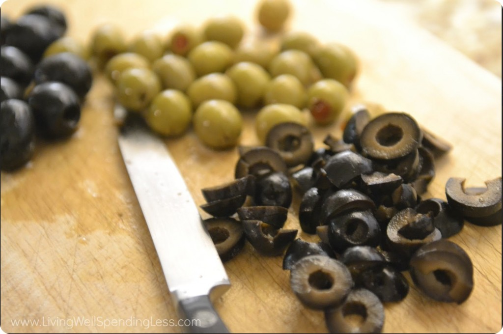 Slice the black and green olives