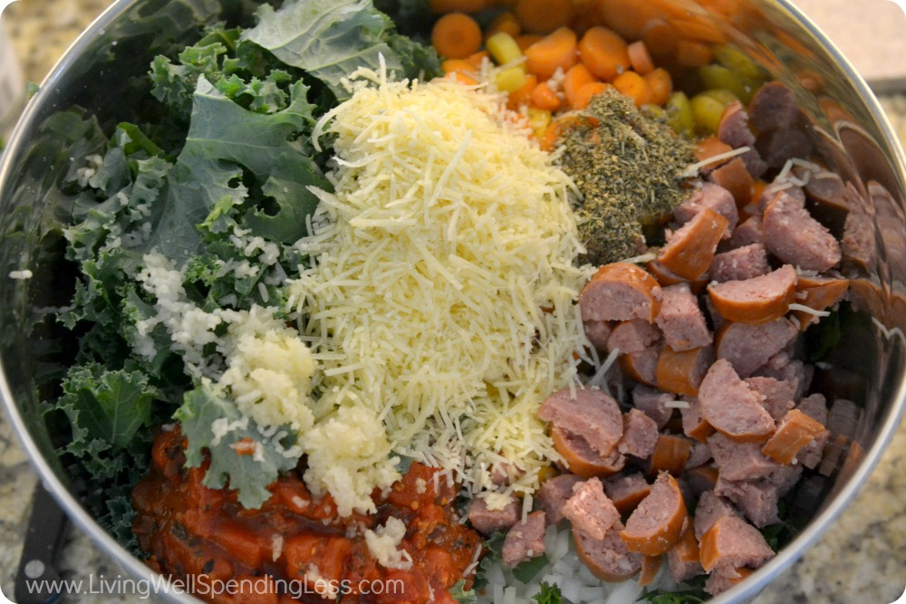 Add the kale, sausage, tomatoes and chopped veggies to a bowl and top with the shredded cheese.