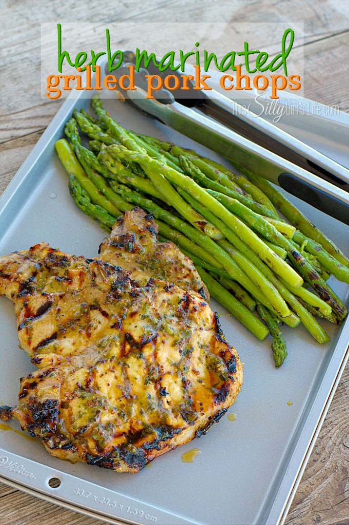 These herb marinated grilled pork chops taste great with asparagus.