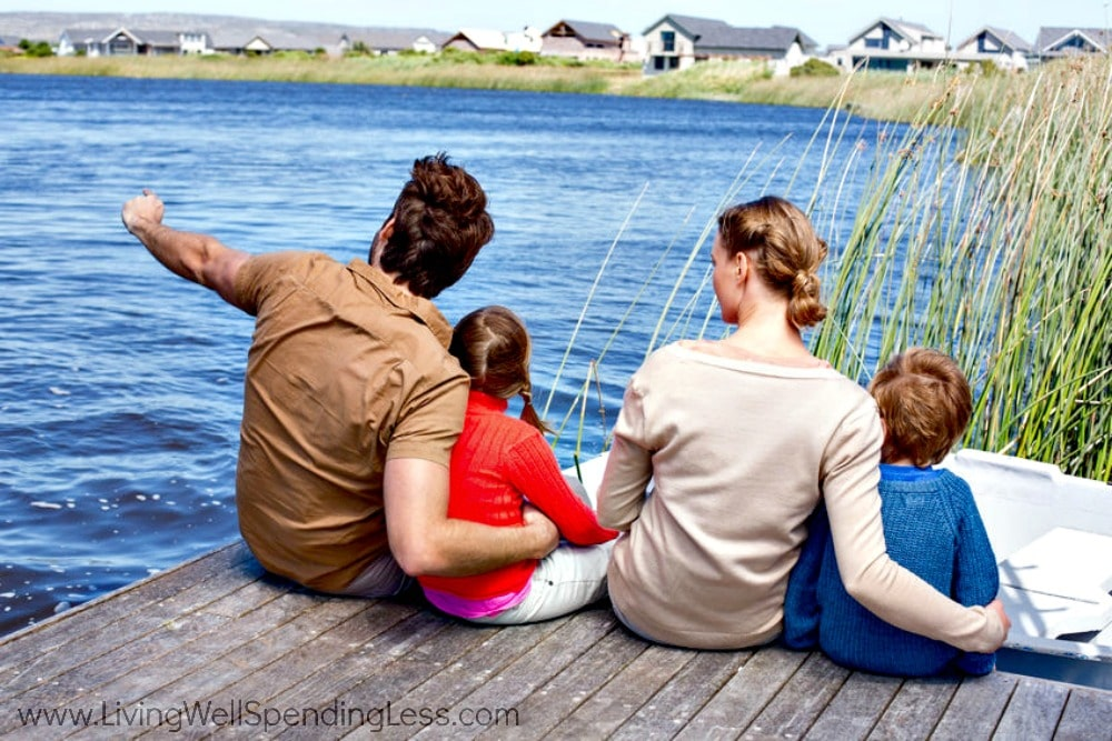 Sitting on the dock of a bay is a great way to spend time as a family.