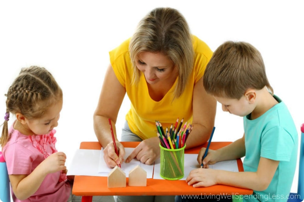Amazing moms do all sorts of activities like coloring with their children.
