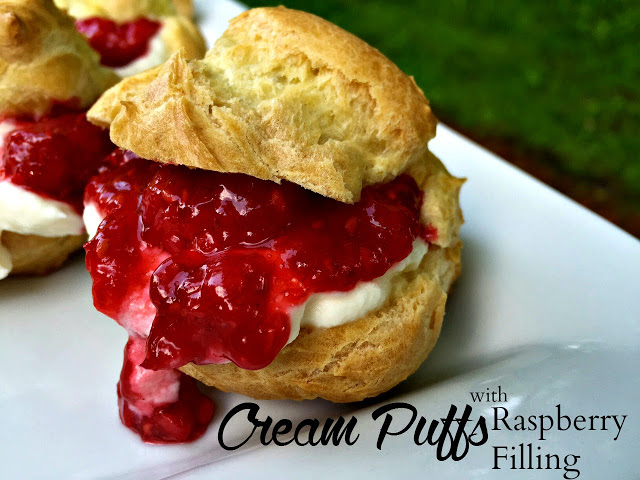 These cream puffs are filled with fresh raspberries.