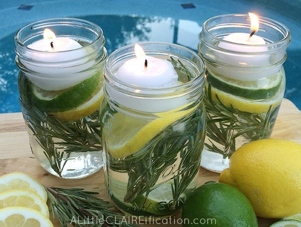 These center pieces hold floating votive candles and fresh lemon pieces.