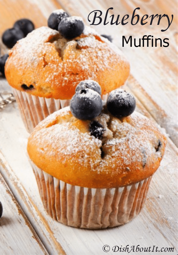 These blueberry muffins dusted with powdered sugar look delicious.