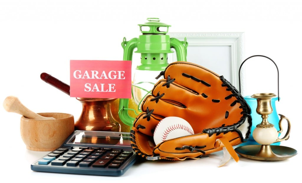 Declutter all the items you no longer use: kitchen wear, camping and sports gear, and sell them at a garage sale.