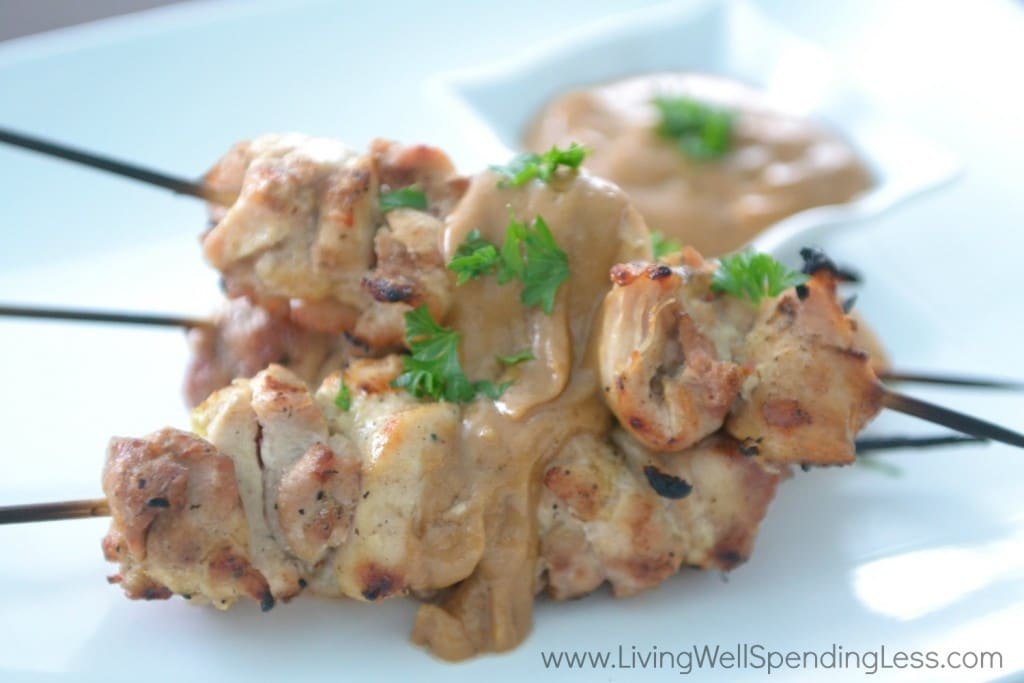 Pour peanut sauce over chicken skewers and serve.