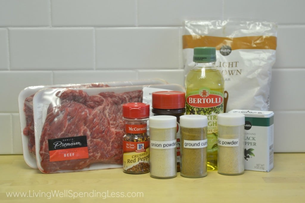 Assemble ingredients to cook your spice rubber steak: olive oil, brown sugar, cumin, chili powder, garlic powder, onion powder, black pepper, red pepper flakes, salt and skirt steak.