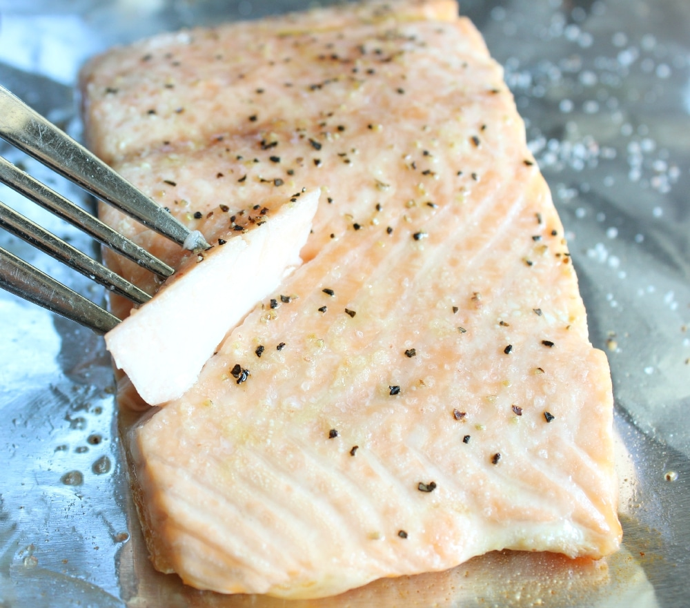 Cook roasted salmon until flaky.