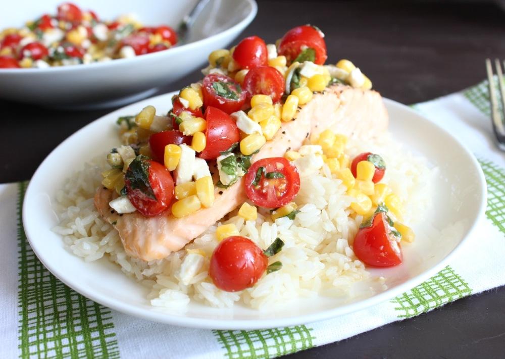 Enjoy roasted salmon, veggie salad, and rice together.