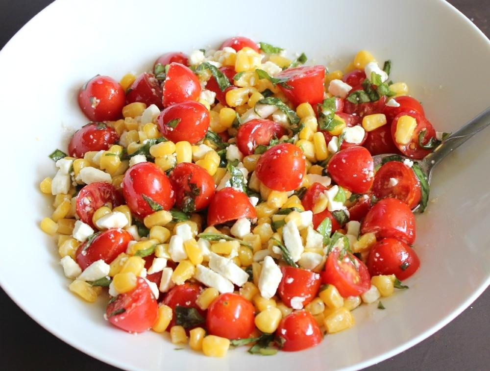 Combine the cherry tomatoes, corn, basil, and feta cheese.