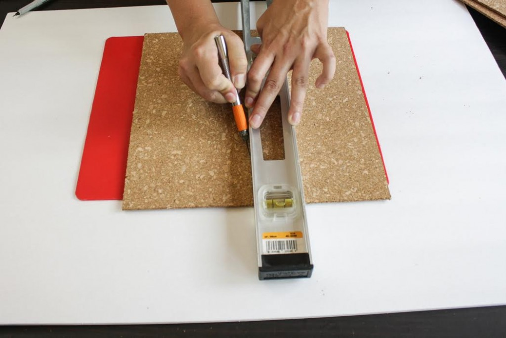 Cut the cork tile in half using a ruler and craft knife.