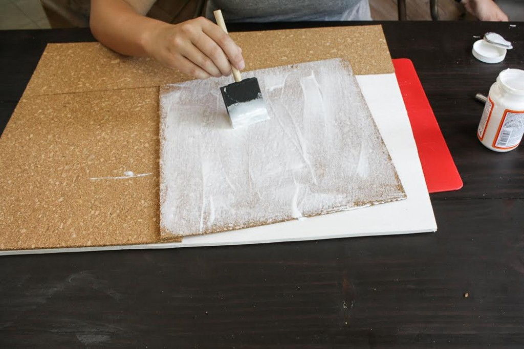 Apply Mod Podge to the cork tiles using a paint brush.