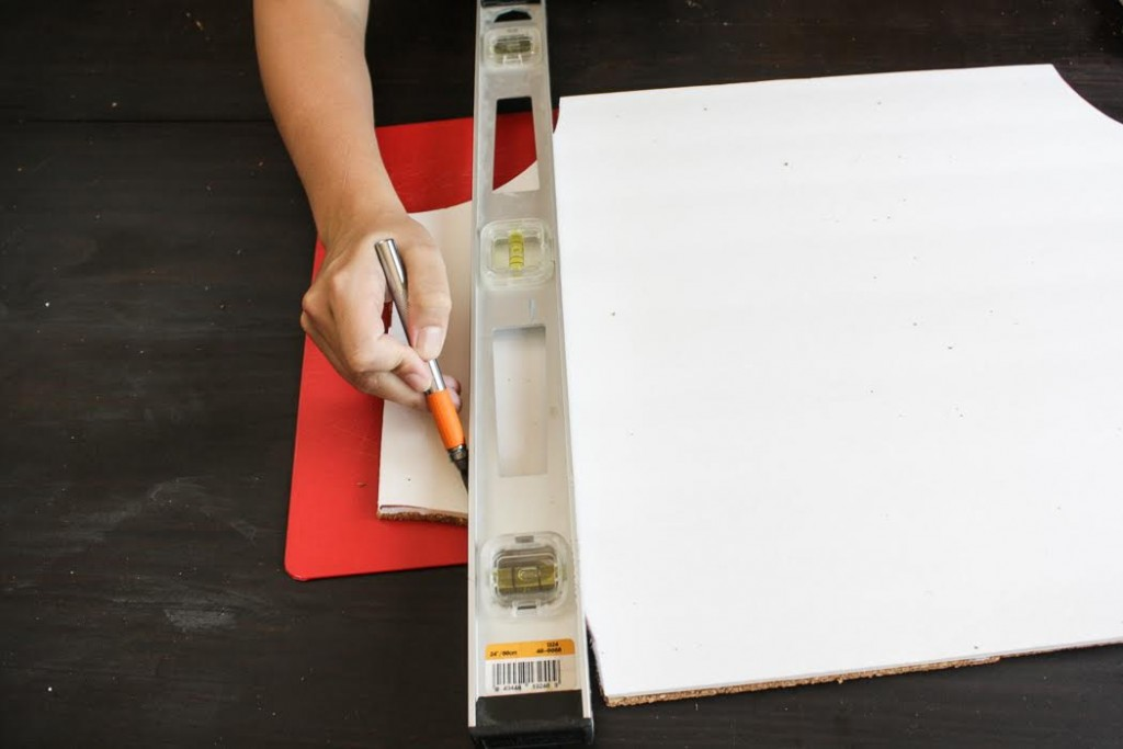 Trim your cork board using a ruler and craft knife.