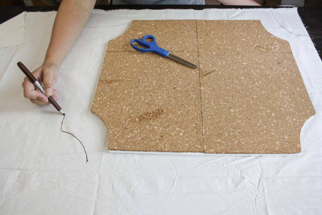 Trace the shape of your cork board using a marker on a piece of fabric.