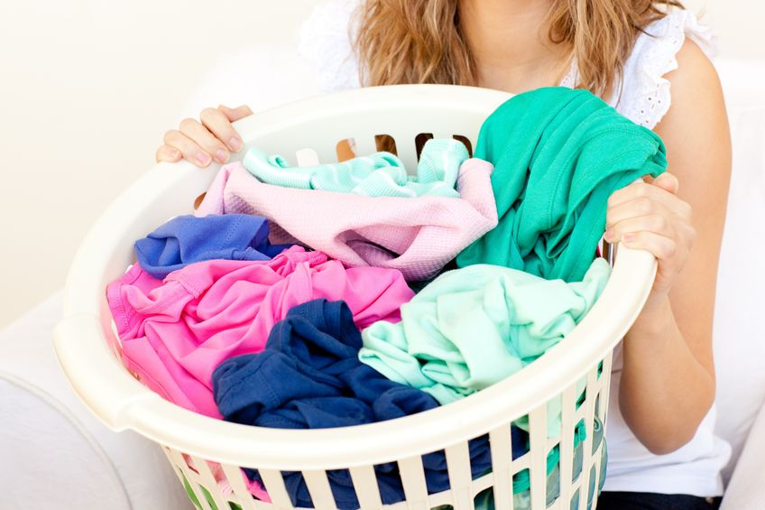 Collect all dirty laundry into a basket or a bin.