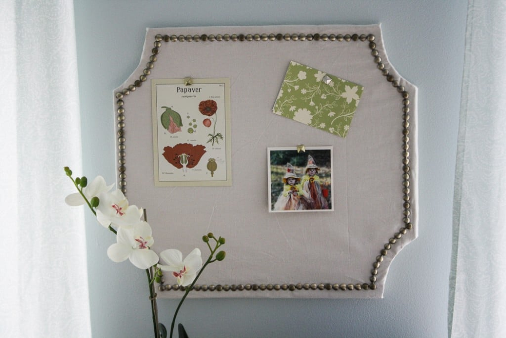 Once the cork board is finished, hang it up on the wall to display photos and notes.