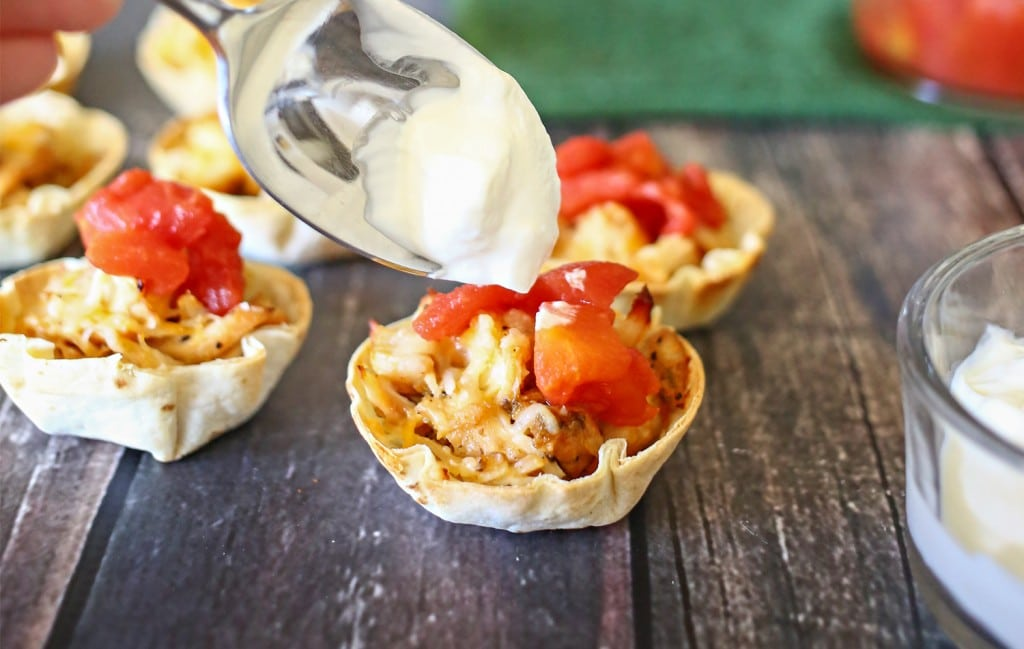 The last step of the easy taco cups recipe is to top with sour cream, delicious!