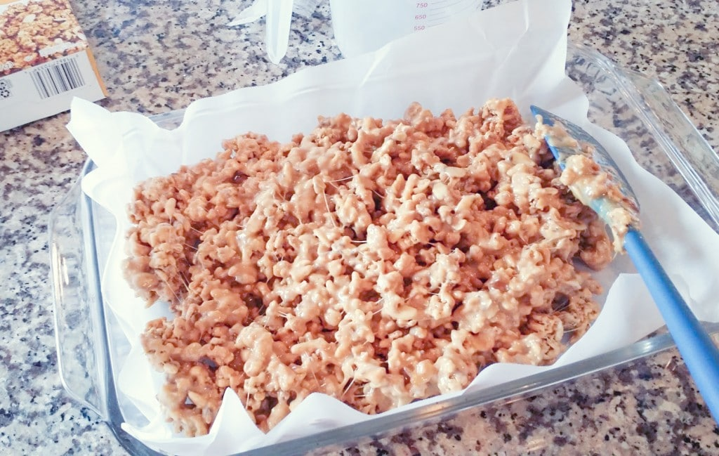 Spread cereal bar mixture in a lined dish