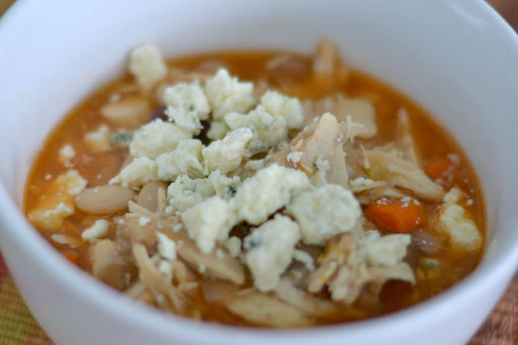 Top the buffalo chicken soup with blue cheese crumbles